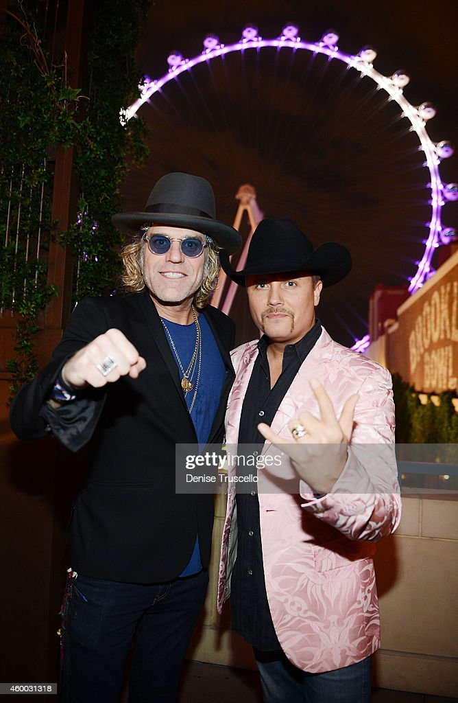 Big Kenny and John Rich of Big & Rich pose for a photo in front of The High Roller at The LINQ Promenade on December 5, 2014 in Las Vegas, Nevada.