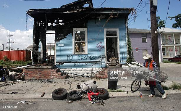 'Big' Lee collects scrap metal in front of a destroyed home in the 7th Ward August 28 2006 in New Orleans Louisiana The first anniversary of...