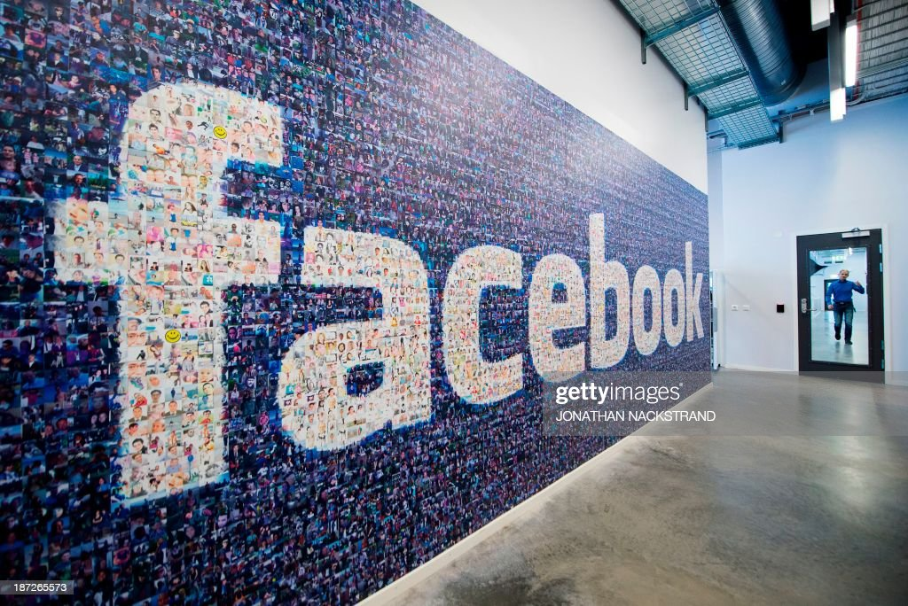 A big logo created from pictures of Facebook users worldwide is pictured in the company's Data Center, its first outside the US on November 7, 2013 in Lulea, in Swedish Lapland. The company began construction on the facility in October 2011 and went live on June 12, 2013 and are 100% run on hydro power. AFP PHOTO/JONATHAN NACKSTRAND
