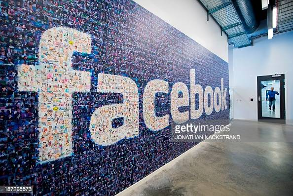 A big logo created from pictures of Facebook users worldwide is pictured in the company's Data Center its first outside the US on November 7 2013 in...
