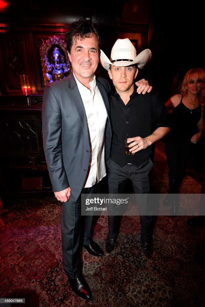 Big Machine Label Group President and CEO <a gi-track='captionPersonalityLinkClicked' href=/galleries/search?phrase=Scott+Borchetta&family=editorial&specificpeople=4462508 ng-click='$event.stopPropagation()'>Scott Borchetta</a> (L) and country music artist <a gi-track='captionPersonalityLinkClicked' href=/galleries/search?phrase=Justin+Moore&family=editorial&specificpeople=2437772 ng-click='$event.stopPropagation()'>Justin Moore</a> attend the Big Machine Label Group Crown Royal after party for the American Country Awards 2013 at the House of Blues Las Vegas Foundation Room inside the Mandalay Bay Resort and Casino on December 10, 2013 in Las Vegas, Nevada.