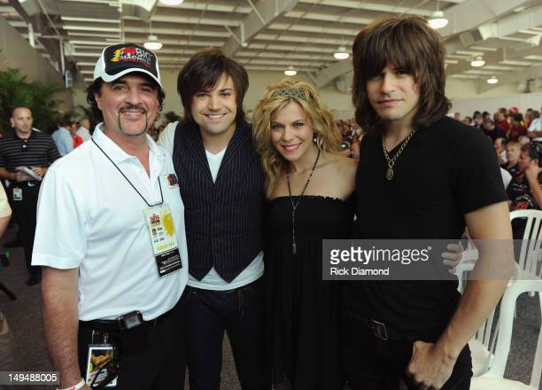 Big Machine Label Group President and CEO Scott Borchetta with Neil Perry Kimberly Perry and Reid Perry of The Band Perry attend the Brickyard 400...