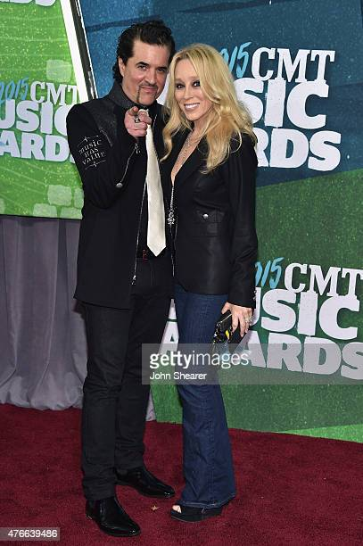 Big Machine Label Group President CEO Scott Borchetta and Sandi Spika Borchetta attend the 2015 CMT Music awards at the Bridgestone Arena on June 10...