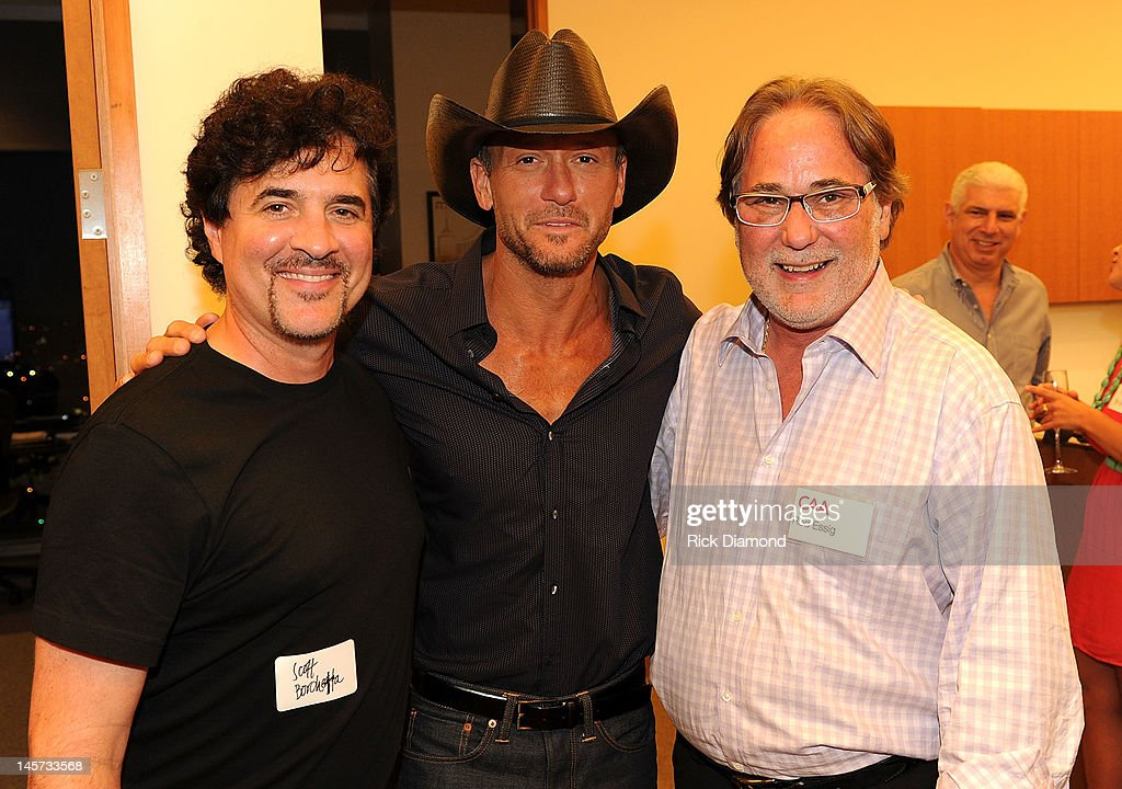 Big Machine Label Group's <a gi-track='captionPersonalityLinkClicked' href=/galleries/search?phrase=Scott+Borchetta&family=editorial&specificpeople=4462508 ng-click='$event.stopPropagation()'>Scott Borchetta</a>, <a gi-track='captionPersonalityLinkClicked' href=/galleries/search?phrase=Tim+McGraw&family=editorial&specificpeople=202845 ng-click='$event.stopPropagation()'>Tim McGraw</a>, and CAA's Rod Essig celebrate the new CAA Nashville offices at the 20th Annual CAA BBQ on June 4, 2012 in Nashville, Tennessee.