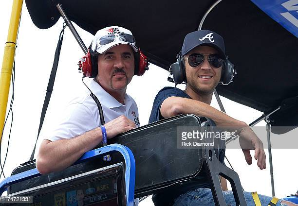Big Machine Records CEO and President Scott Borchetta and Justin Moore in the 99 Carl Edwards Pit during Brickyard 400 Presented By Big Machine Label...