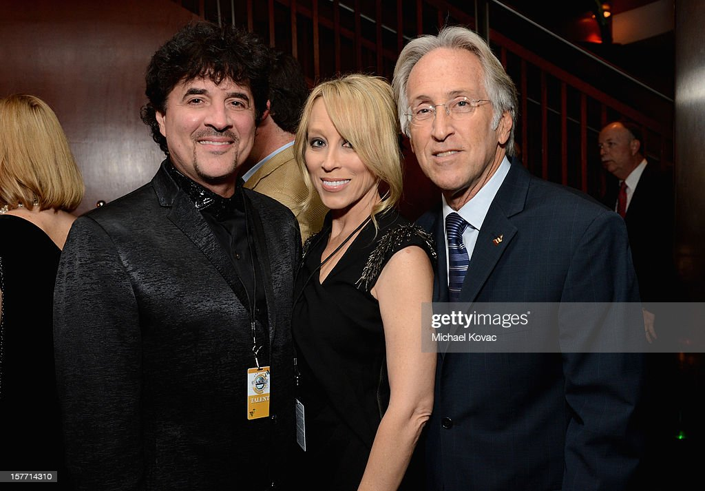Big Machine Records founder <a gi-track='captionPersonalityLinkClicked' href=/galleries/search?phrase=Scott+Borchetta&family=editorial&specificpeople=4462508 ng-click='$event.stopPropagation()'>Scott Borchetta</a>, Sandy Borchetta and President/CEO of The Recording Academy <a gi-track='captionPersonalityLinkClicked' href=/galleries/search?phrase=Neil+Portnow&family=editorial&specificpeople=208909 ng-click='$event.stopPropagation()'>Neil Portnow</a> attend The GRAMMY Nominations Concert Live!! pre-show reception held at Bridgestone Arena on December 5, 2012 in Nashville, Tennessee.