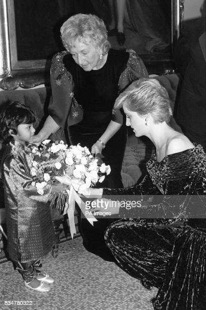 Big moment for four year old Juleka Sikdher from Dr Barnado's presenting flowers to Diana Princess of Wales at last night's British Fashion Banquet...