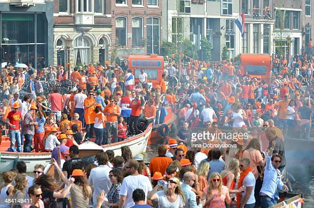 big party on boats on canal in Amsterdam Kings Day celebrations The Netherlands