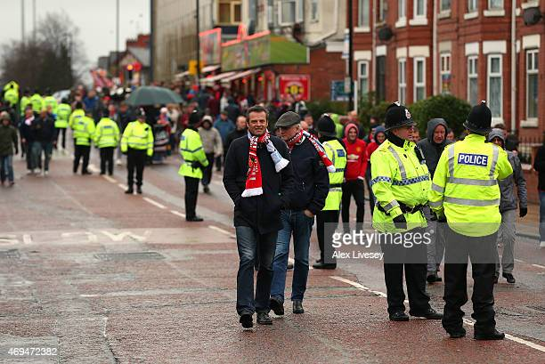 A big police presence is seen outside Old Trafford as fans arrive for the Barclays Premier League match between Manchester United and Manchester City...