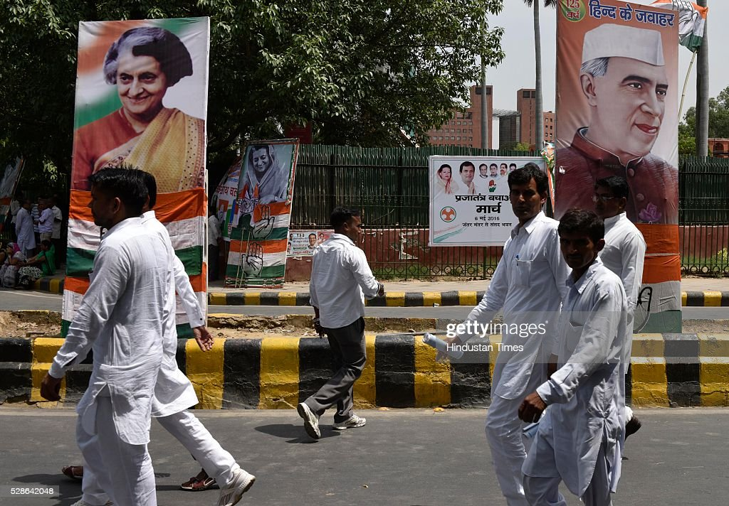 Big posters of former Prime ministers Jawaharlal Nehru and Indira Gandhi on the road side during Congress party march from Jantar Mantar to Parliament on May 6, 2016 in New Delhi, India. The protest march called to highlight what the Congress party terms as Modis attack on democracy saw thousands of party workers gather at Jantar Mantar, the countrys protest capital. Congress president Sonia Gandhi, party vice-president Rahul Gandhi and former prime minister Manmohan Singh were briefly arrested and then released at the Parliament Street police station.