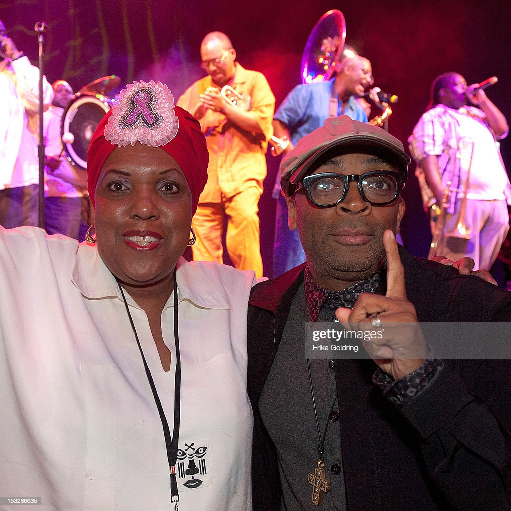 Big Queen Cherise Harrison-Nelson of Guardians of the Flame Mardi Gras Indians and Director Spike Lee dance to the music of Hot 8 Brass Band at the 'Flip the Script' Public Awareness campaign launch at The Joy Theater on October 2, 2012 in New Orleans, Louisiana.