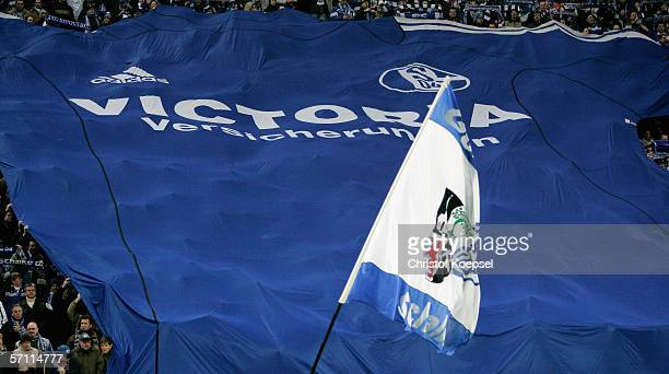 A big Schalke jersey is shown in the fan's corner during the UEFA Cup Round of 16 second leg match between Schalke 04 and US Citta di Palermo at the...