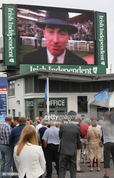 Big Screen Tributes are paid during day two of the 2013 Galway Summer Festival at Galway Racecourse Ballybrit Ireland to broadcaster Colm Murray who...