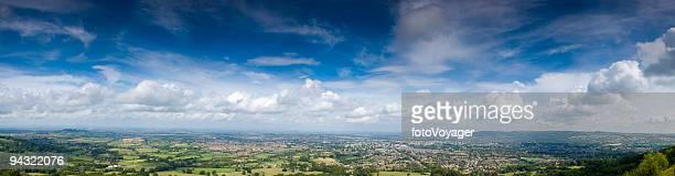 Big sky, town, green fields
