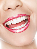big smile with gloss and glitter on lips
