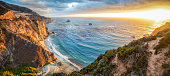 Panoramic view of beautiful Big Sur coastal landscape in beautiful golden evening light at sunset with dramatic clouds in summer, California, Monterey County, USA