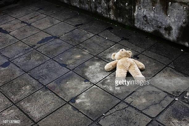 BIg teddy bear falling down on the roof