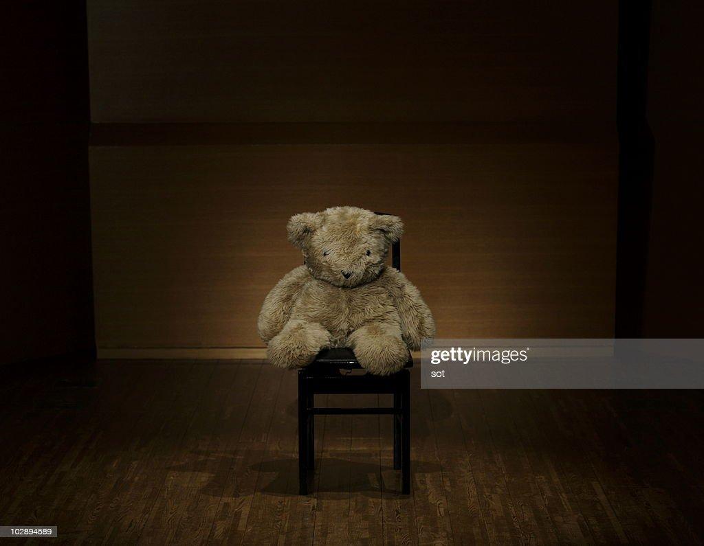 Big teddy bear sitting down on the chair  : Stock Photo