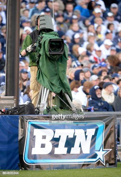 Big Ten Network BTN videographer operates a broadcast video camera on a tripod in the end zone during the game The Penn State Nittany Lions defeated...