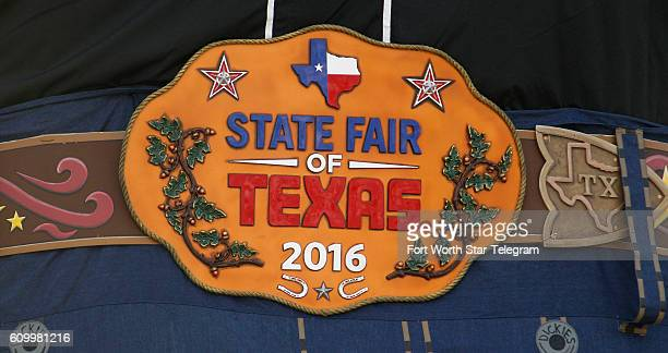 Big Tex belt buckle and all is lifted into place with the State Fair of Texas one week away from opening at the Midway in Dallas on Friday Sept 23...