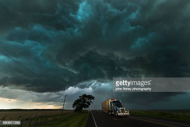 Big truck drives under a thunderstorm. Texas, USA