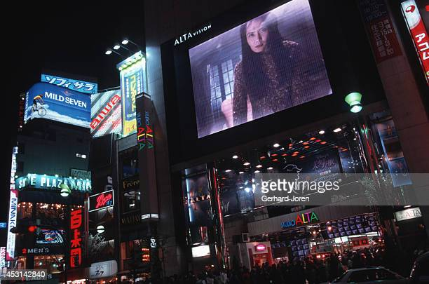 Big TV screens on a department store near Shinjuku train station Tokyo