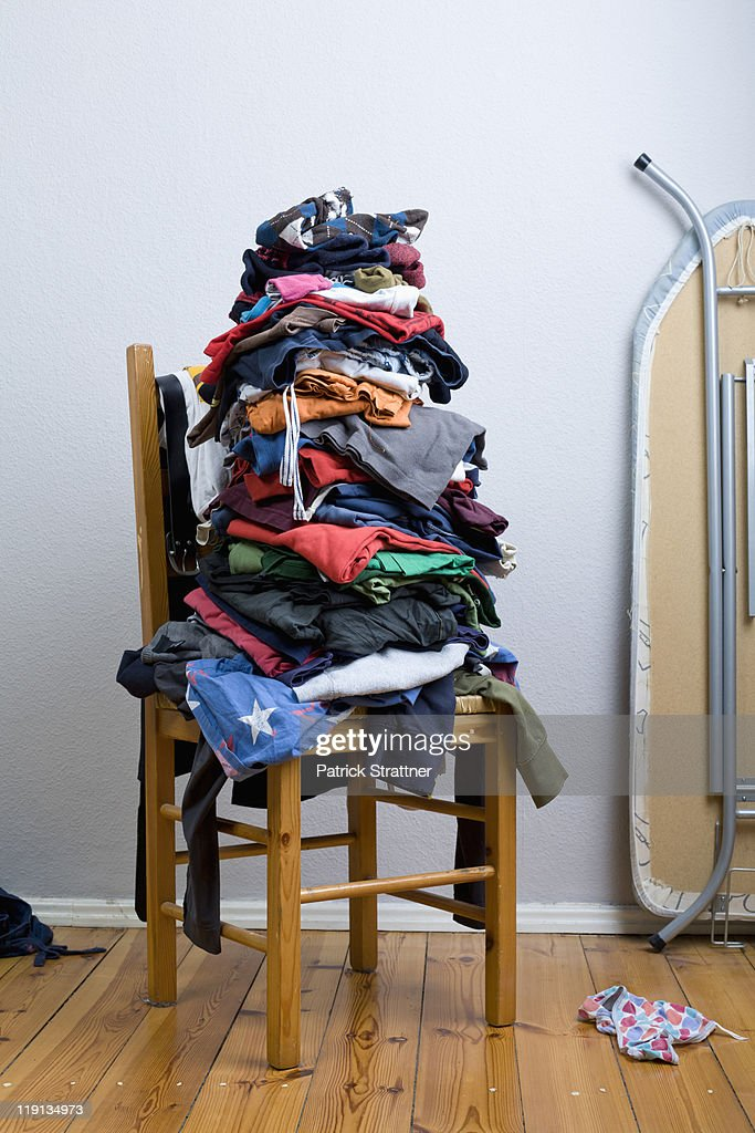 A big untidy stack of clean clothes waiting to be ironed : Stock Photo