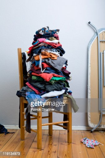 A big untidy stack of clean clothes waiting to be ironed