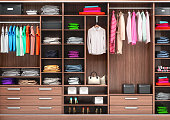 Big wardrobe with different clothes for dressing room. 3d illustrations