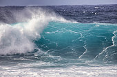 Big wave crashing with spray blowing up on the air