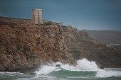 Sea storm from Malta Golden Bay coast, big waves and rock
