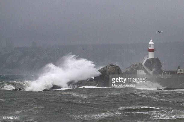 Big waves hit the shore during a frontal system of strong winds on July 13 2016 in Valparaiso Chile