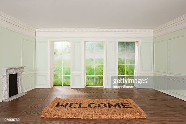 Big welcome mat in tiny room