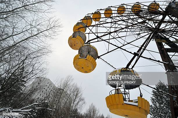 A big wheel stands derelict in the ghost city of Prypyat near Chernobyl nuclear power plant on February 22 2011 Today Ukraine's Emergency ministry...