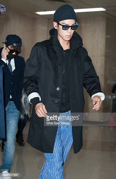 BigBang are seen at Gimpo International Airport on April 14 2014 in Gimpo South Korea