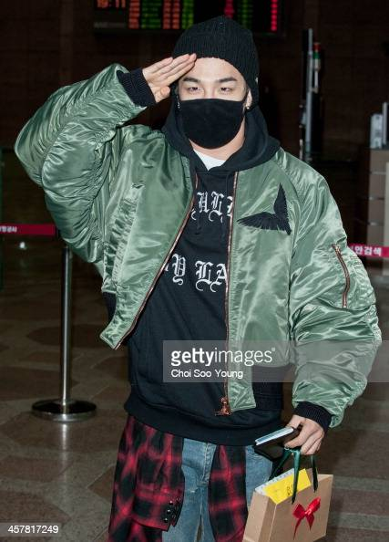 Bigbang is seen at Gimpo International Airport on December 18 2013 in Seoul South Korea
