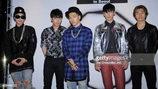 BigBang pose for photographs during the NONA9ON launching party at Club Octagon on September 11 2014 in Seoul South Korea