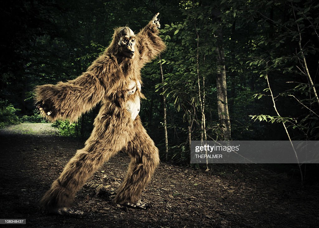 bigfoot making a disco dancing step on the road : Stock Photo