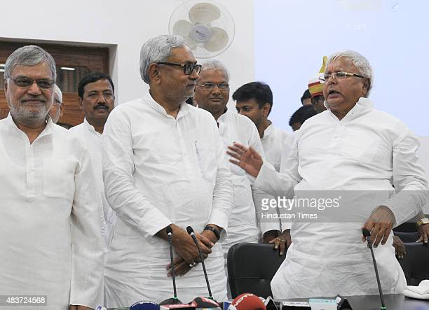 Bihar Chief Minister and JD leader Nitish Kumar with RJD Chief Lalu Yadav during a joint press conference to announce Maha Gathbandhan on August 12...