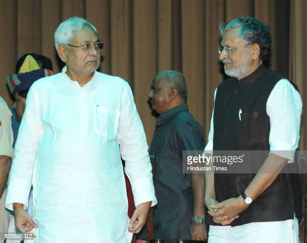Bihar Chief Minister Nitish Kumar and BJP leader Sushil Modi after taking oath at Raj Bhawan on July 27 2017 in Patna India Nitish Kumar walked back...
