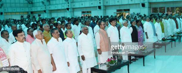 Bihar Chief Minister Nitish Kumar and Deputy Chief Minister Sushil Modi with others at Raj Bhawan on July 27 2017 in Patna India Nitish Kumar walked...