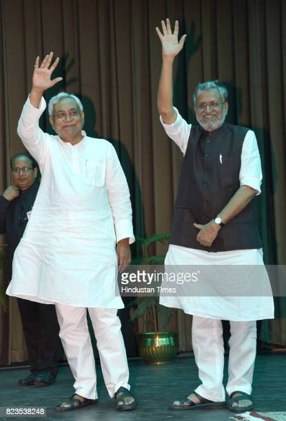 Bihar Chief Minister Nitish Kumar and Deputy Chief Minister Sushil Modi at Raj Bhawan on July 27 2017 in Patna India Nitish Kumar walked back into...