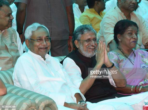 Bihar Chief Minister Nitish Kumar and Deputy Chief Minister Sushil Modi at Rajbhawan on July 27 2017 in Patna India Nitish Kumar walked back into the...
