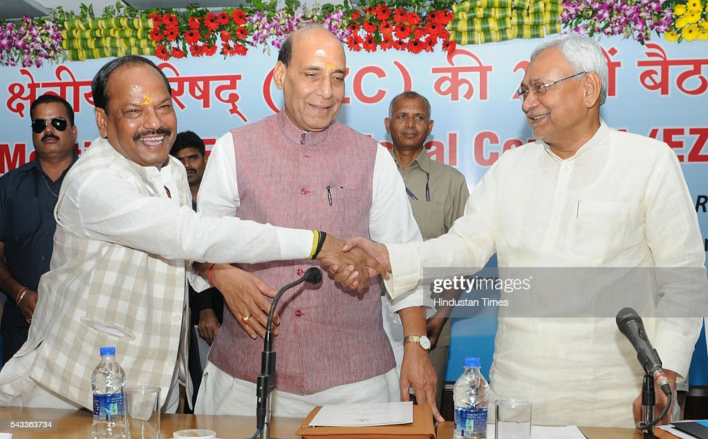 Bihar Chief Minister Nitish Kumar and Jharkhand Chief Minister Raghubar Das warmly greets each other before the Union Home Minister Rajnath Singh during the 22nd meeting of Eastern Zonal Council at IICM campus on June 27, 2016 in Ranchi, India.