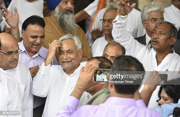 Bihar Chief Minister Nitish Kumar leaves after swearing in ceremony of the new president Ram Nath Kovind at Parliament House on July 25 2017 in New...
