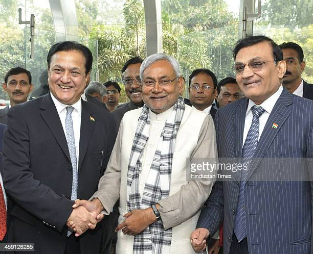 Bihar Chief Minister Nitish Kumar shakes hand with Managing Director and CEO Yes Bank Rana Kapoor as Director Videocon Industries Limited Rajkumar...