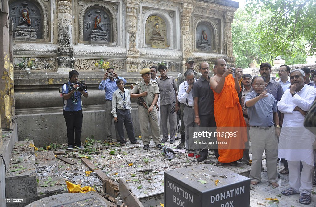 Bihar Chief Minister Nitish Kumar (R) visit The World Heritage Mahabodhi Temple after a series of blast took place in Budh temples at Bodhgaya on July 7, 2013 in Bihar, India. Nine serial explosions today rocked the internationally renowned temple town of Bodhgaya. Two people have been injured in a series of blasts inside the Mahabodhi temple in Bihar's Bodhgaya district.