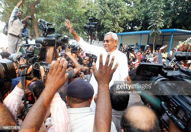 Bihar Chief Minister Nitish Kumar waves to the crowd gathered outside his residence on the vote counting day of the Bihar assembly elections on...