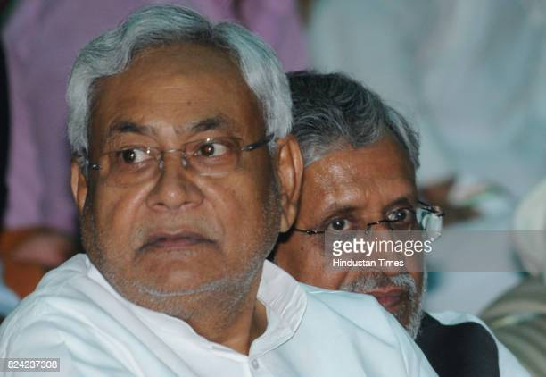 Bihar Chief Minister Nitish Kumar with Deputy Chief Minister Shushil Modi at oath taking ceremony of ministers at Raj Bhawan on July 29 2017 in Patna...