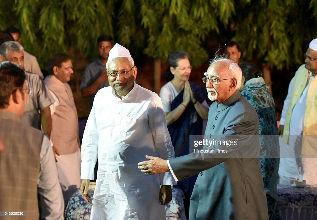 Bihar Chief Minister Nitish Kumar with Vice President Hamid Ansari at iftar of JDU party at the residence of former JDU president and Rajya Sabha member Sharad Yadav at 7 Tughlak Road on June 29, 2016 in New Delhi, India.